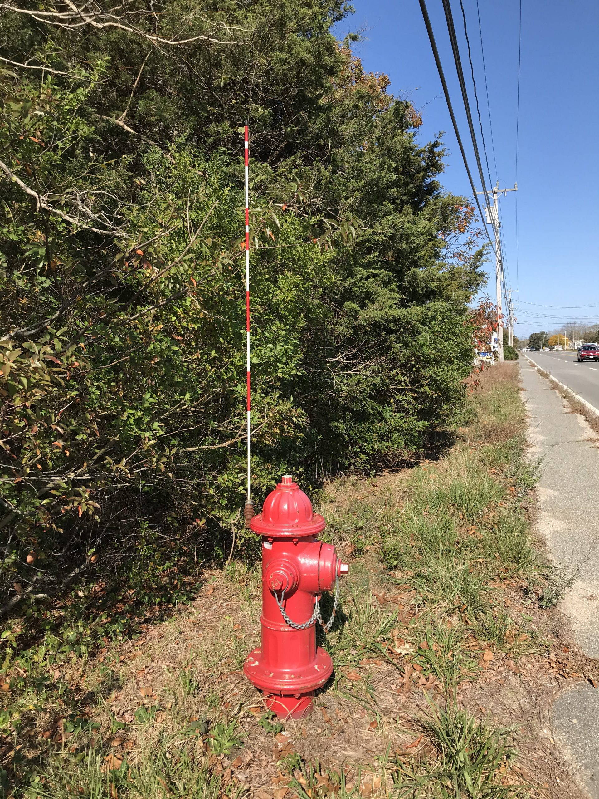 A red fire hydrant with an antenna sticking up from it