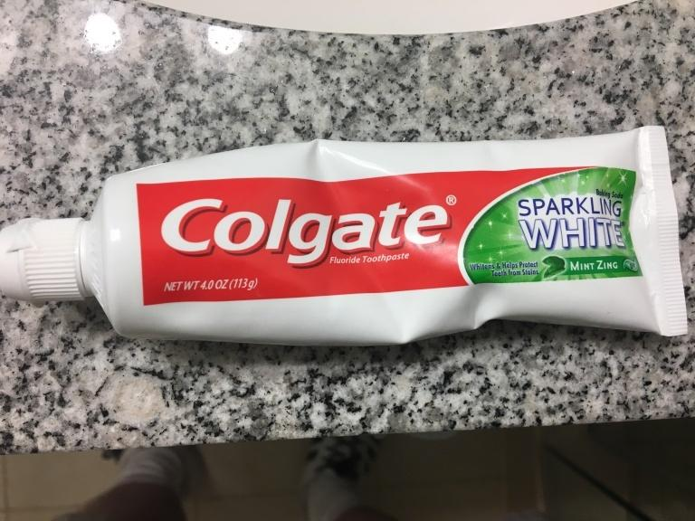 Toothpaste tube squeezed in the middle